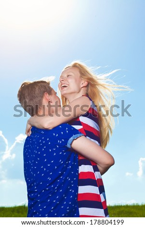 portrait of young happy beautiful couple on nature - stock photo