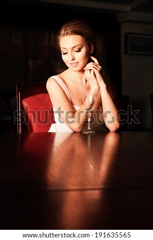 Portrait of young happy beautiful woman in restaurant.