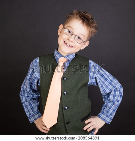 Portrait of young happy boy over theblack - stock photo