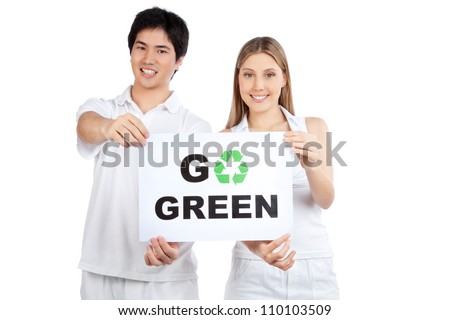 Portrait of young happy couple holding blank placard. - stock photo