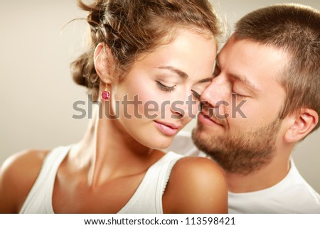 Portrait of young happy  couple, isolated on white background - stock photo