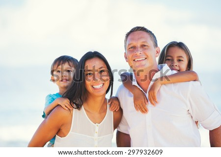 Portrait of Young Happy Family - stock photo