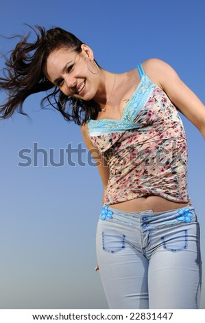 Portrait of young happy girl enjoying the summer breeze outdoors - stock photo