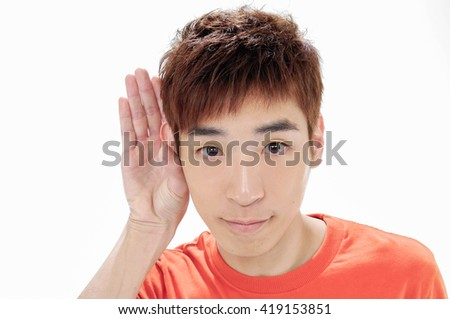 Portrait of young happy joyful man with hands gesture - stock photo
