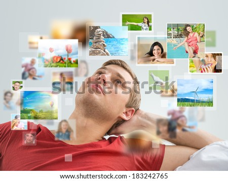 Portrait of young happy man sharing his travel photo and video files in social media  - stock photo