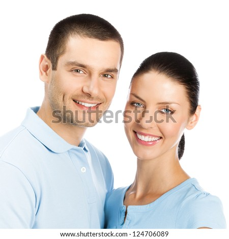 Portrait of young happy smiling attractive couple, isolated over white background - stock photo