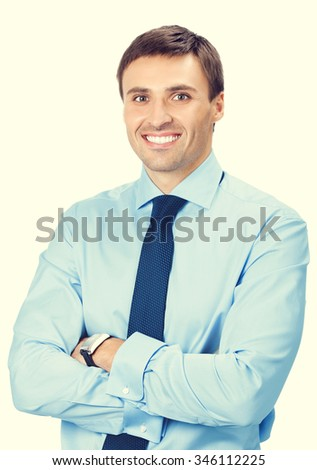 Portrait of young happy smiling business man - stock photo