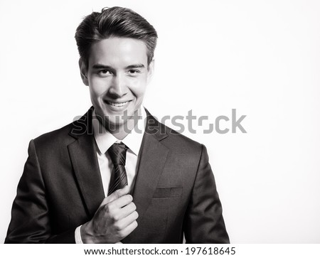 Portrait of young happy smiling business man, isolated over white background. - stock photo