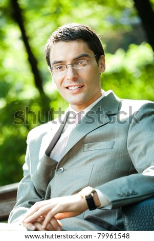Portrait of young happy smiling business man, outdoors