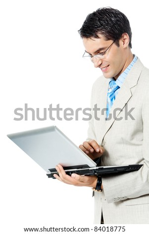 Portrait of young happy smiling business man working with laptop, isolated over white background
