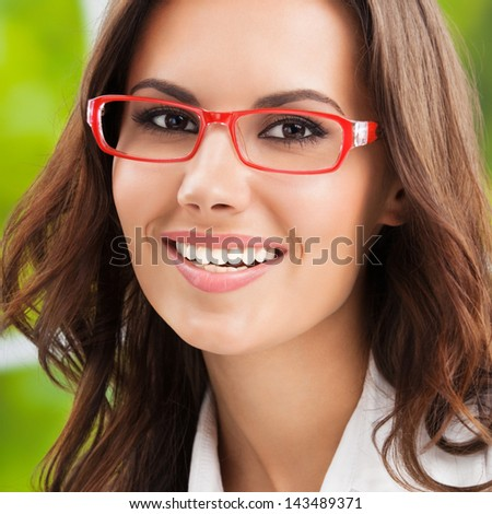 Portrait of young happy smiling business woman at office