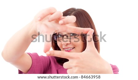 Portrait of young happy smiling business woman framing her face with hands - stock photo