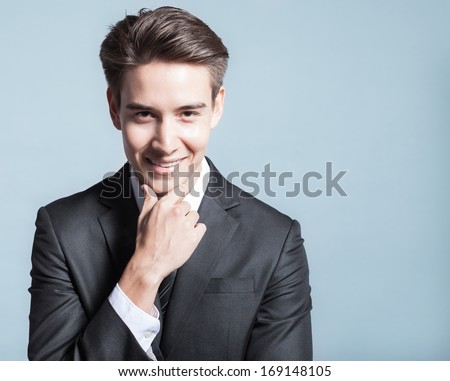 Portrait of young happy smiling businessman