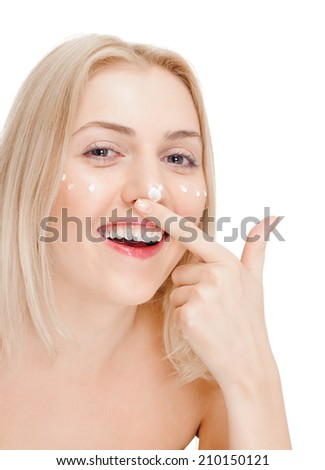 Portrait of young happy smiling cheerful beautiful blond woman applying cream. white background