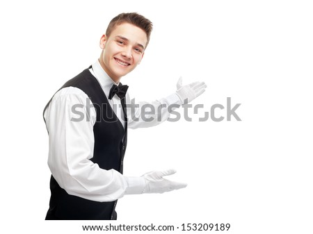 Portrait of young happy smiling waiter gesturing welcome isolated on white background - stock photo