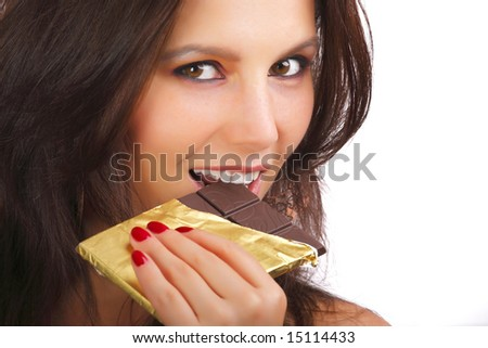 Portrait of young happy smiling woman eating chocolate