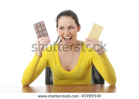 Portrait of young happy smiling woman eating dark and white chocolate - stock photo