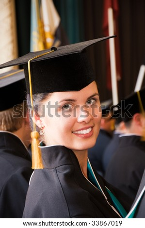 Portrait of young happy student (Shallow dof) - stock photo