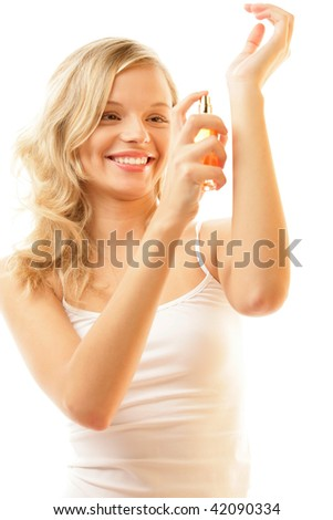 Portrait of young happy woman applying perfume on her wrist isolated on white background - stock photo