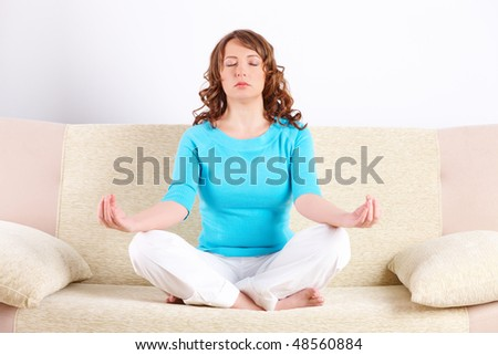 Portrait of young happy woman doing yoga exercise - stock photo