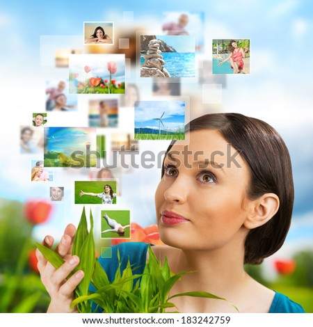 Portrait of young happy woman sharing her photo and video files in social media  - stock photo