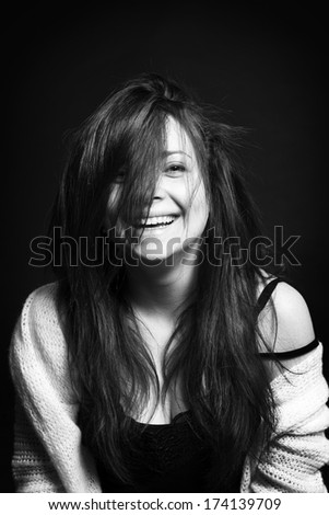 Portrait of young happy woman smiling - stock photo