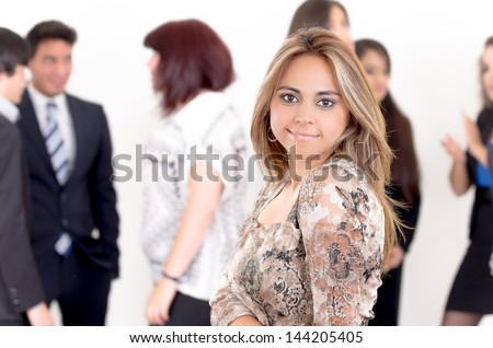 Portrait of young happy woman with her business partners on the background - stock photo