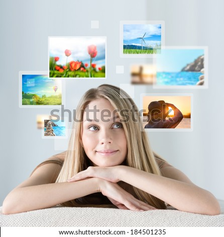 Portrait of young happy woman with travel vacation memories or expectations around her - stock photo