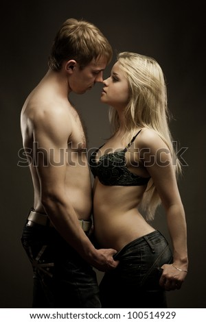 Portrait of young heterosexual couple loving each over with passion