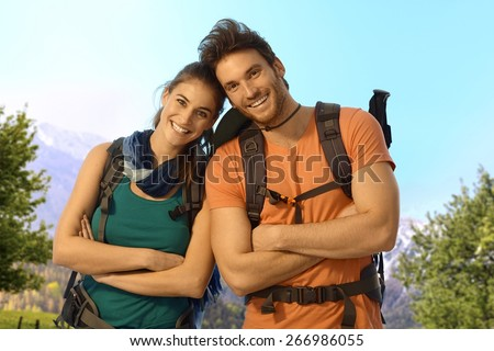 Portrait of young hikers outdoor on a sunny spring day, looking at camera, smiling. - stock photo