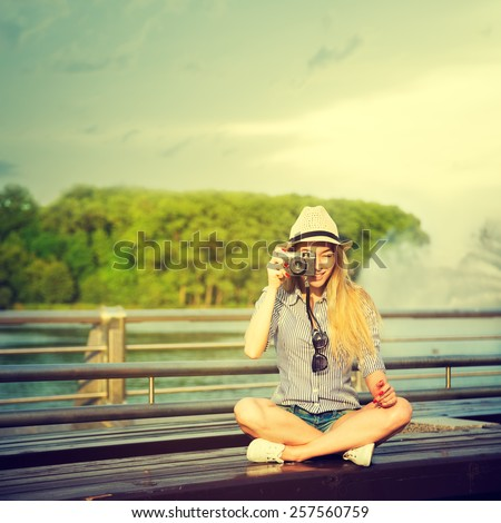 Portrait of Young Hipster Girl Making Photo with Vintage Camera. Modern Youth Lifestyle Concept. Toned Instagram Styled Photo. - stock photo