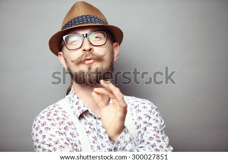 Portrait of young hipster showing perfect gesture