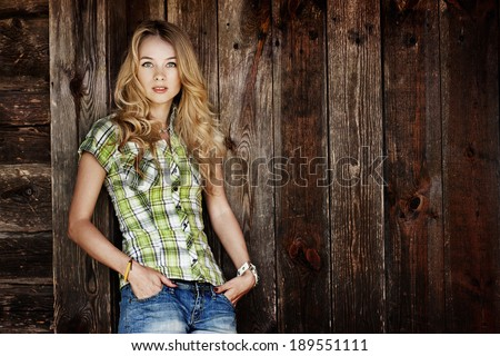 Portrait of Young Hipster Woman on Wooden Wall Background. Summer Urban Fashion Concept. - stock photo
