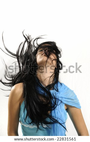 Portrait of young hispanic beauty waving her hair - isolated