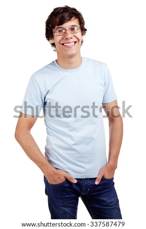 Portrait of young hispanic man wearing glasses, blue t-shirt and jeans standing with hands in pockets and smiling isolated on white background - stock photo