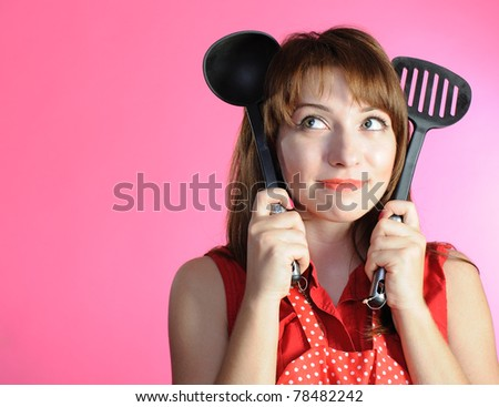 Portrait of young housewife with ladle
