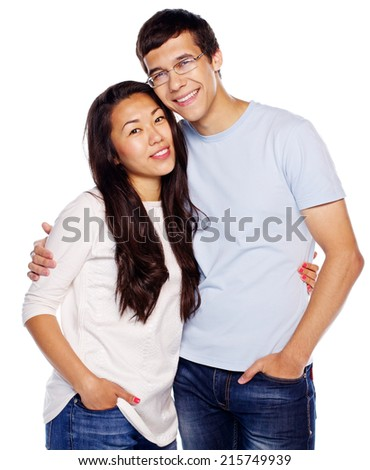 Portrait of young hugging couple isolated on white background