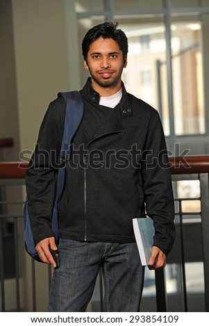 Portrait of young Indian student inside school building