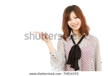 Portrait of young japanese business woman pointing - stock photo