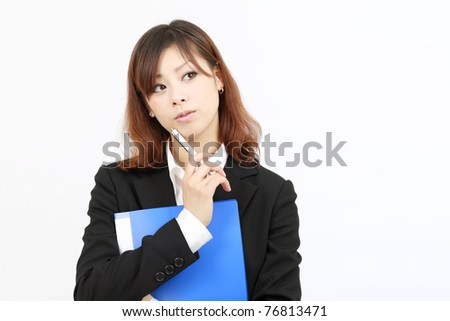 portrait of young japanese business woman thinking