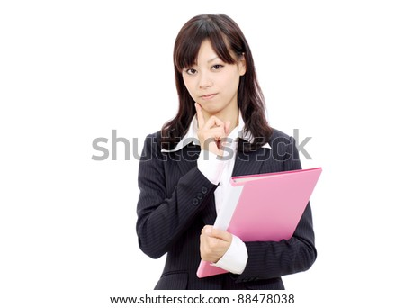 Portrait of young japanese business woman thinking - stock photo