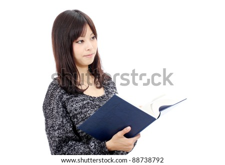 Portrait of young japanese woman reading book