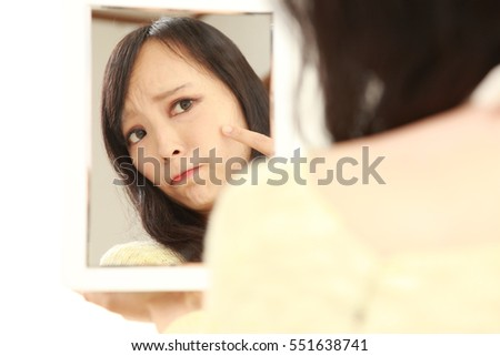 portrait of young Japanese woman worries about dry rough skin