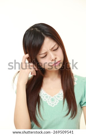 portrait of young Japanese woman worries about something