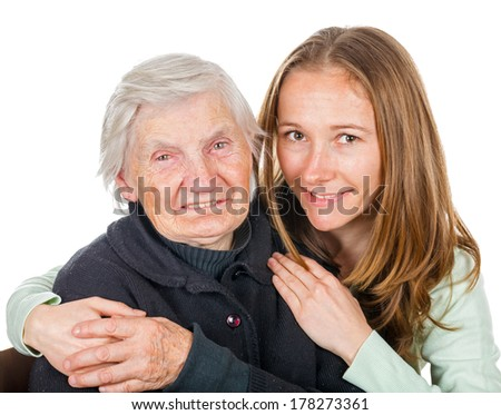Portrait of young lady embracing the elderly woman