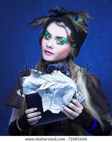 Portrait of young lady in creative image and with book in her hands. - stock photo