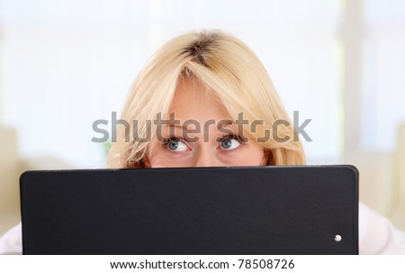 portrait of young lady with notebook in office