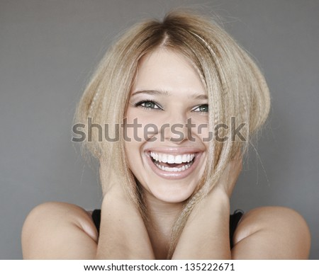 portrait of young laughing woman - stock photo