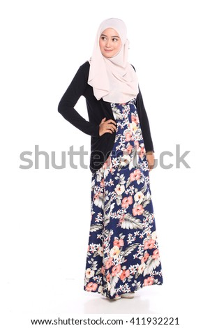 portrait of young malay woman in full shot posing with her dress isolated in white - stock photo