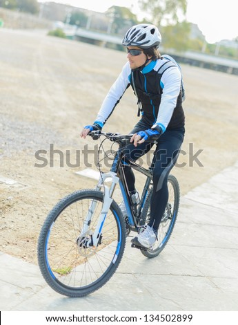Portrait Of Young Male Cyclist; Outdoors - stock photo